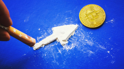 Bitcoina - digital cryptocurrency and euro on a blue background golden bitcoins with the spotlight. The white powder with money. Bitcoina - digital cryptocurrency and euro on a blue background golden