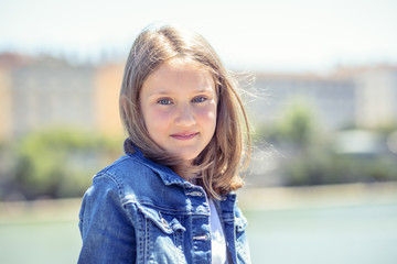 Outdoor portrait of cute young girl