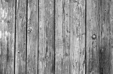 Old grunge wooden fence pattern in black and white.