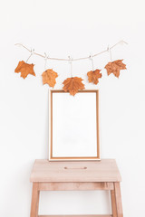 Autumn composition. Photo frame, autumn garland on white background. Flat lay, top view, copy space