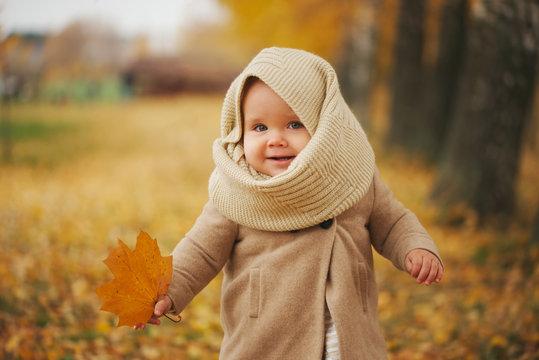 cute happy girl in autumn park
