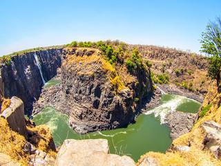 Victoria Falls on Zambezi River. Dry season. Border between Zimbabwe and Zambia, Africa. Fisheye shot.