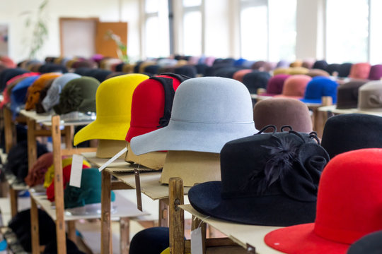 Sale of felt hats bright colors in the store