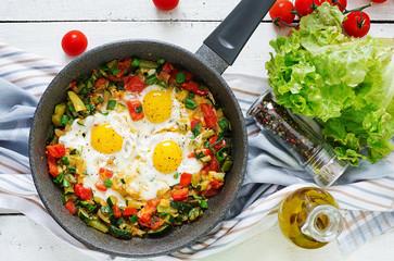 Aluminium Prints Egg Tasty breakfast. Fried eggs with vegetables. Shakshuka. Top view. Flat lay