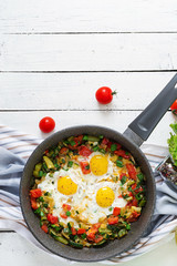 Tasty breakfast. Fried eggs with vegetables. Shakshuka. Top view. Flat lay