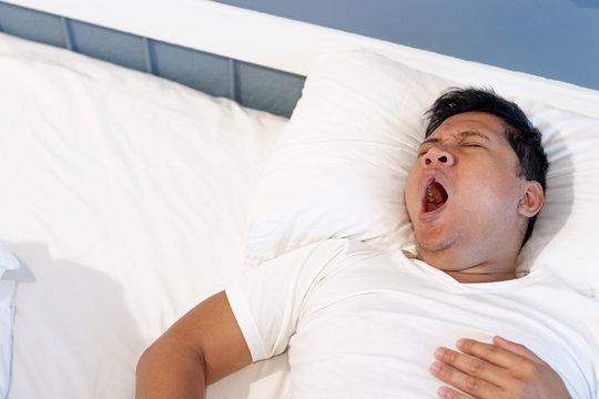 Man sleeping in him bed.