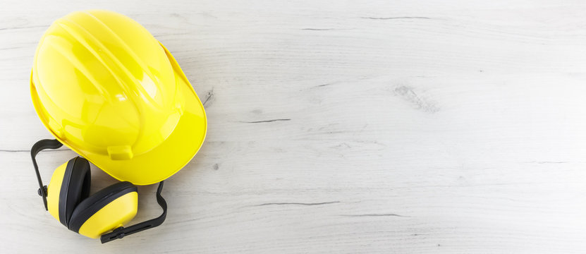 Banner Image of Yellow Hardhat and Earmuffs with Copy Space