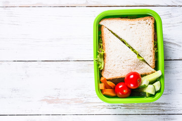 Wall Murals Assortment Lunch box with sandwich and vegetables.