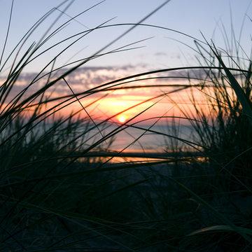 Laesoe / Denmark: Dreamlike sunset with orange-red glowing sky in the dunes at Vesteroe Havn