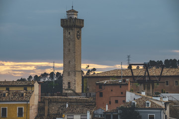 Climber rappeling Mangana Tower at awesome sunset in Cuenca, Spain