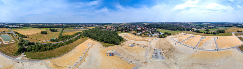 Panorama in high resolution, composed of photos with the drone, with a view of a new development with several streets and dead ends, old village in the background