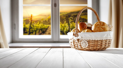 Fresh bread on white wooden table and window background. Free space for your decoration.