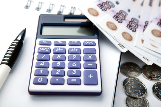 business still-life from a calculator and a bundle of russian banknotes 500 rubles