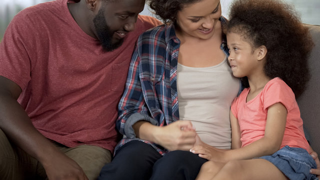 Young parents find approach to shy adopted child, loving and caring family