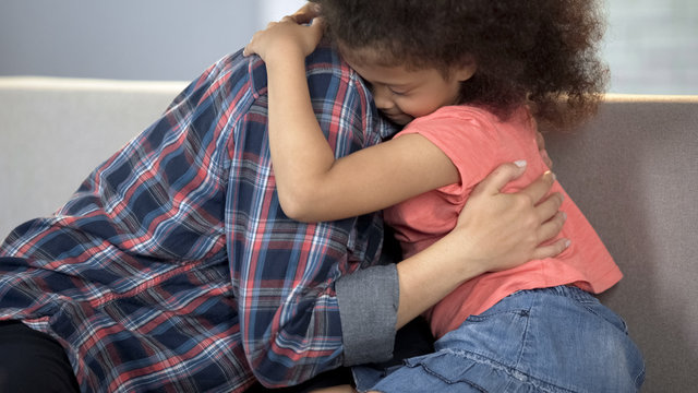 Caring adult lady hugging little girl, child adoption system, family happiness