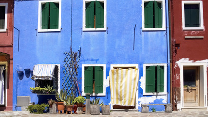 Shabby colorful houses on Burano island in Venice, summer tourism in Italy