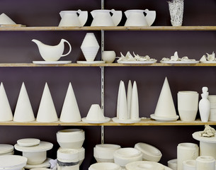 Products on shelf in porcelain workshop