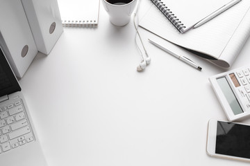 Business Items dropped in creative Disorder on white Table
