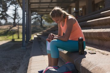 Female athlete using smartwatch