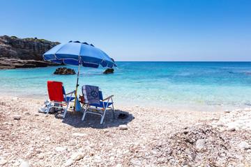 Blue umbrella by the blue sea