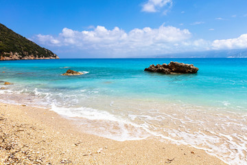 Beach with azure water and white sand