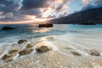 Sunrise by the sea of an Ioanian island