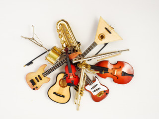 musical instruments. Mini models, toys, souvenirs on a light background.