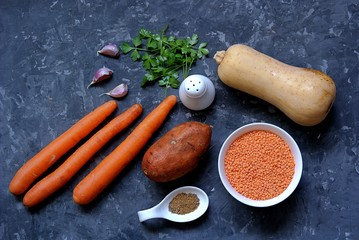 Ingredients for orange Israeli soup with lentils and pumpkin. Red lentils, pumpkin, sweet potatoes, carrots, garlic, spices