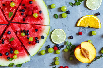 Bright summer wallpaper with watermelon slices, peaches, oranges and berries.