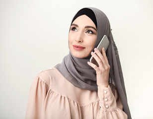 Contemporary islamic woman talking on mobile