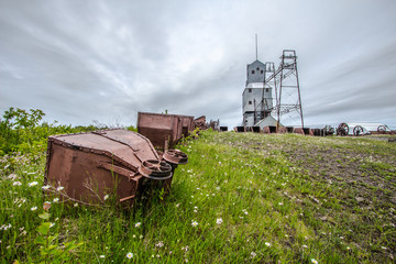 Abandoned Industrial Site. Mine cars abandoned in a field at the Quincy Mine in the Keweenaw National Historical Park in Calumet, Michigan.