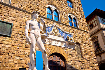 Spoed Fotobehang Florence Piazza della Signoria statue of David by Michelangelo and Palazzo Vecchio of Florence view