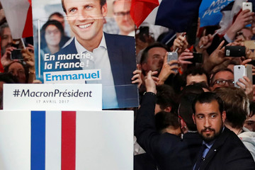 Alexandre Benalla, head of security, looks on as Emmanuel Macron, candidate for the 2017 French presidential election, walks on stage during a campaign political rally in Paris