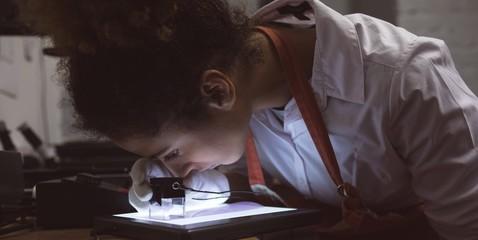 Female photographer using pocket magnifier
