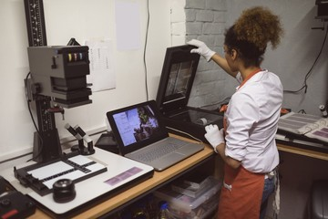 Female photographer using photo scanner