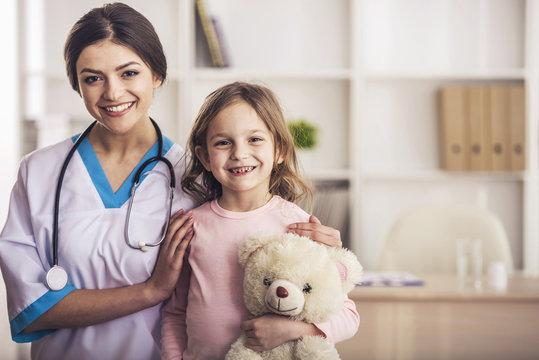 Friendly Doctor with Small Patient.