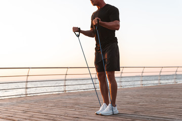 Cropped image of a fit sportsman doing exercises