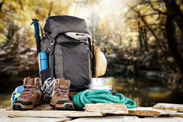 backpack and mountaisn landscape
