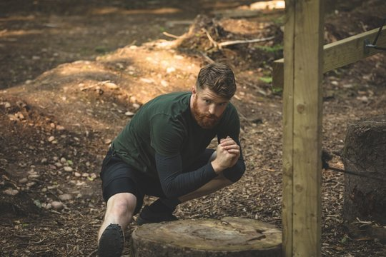 Fit man exercising at boot camp