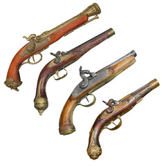Four old vintage firelock gun isolated on white background