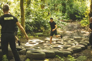 Fit mens training over tyres obstacle course