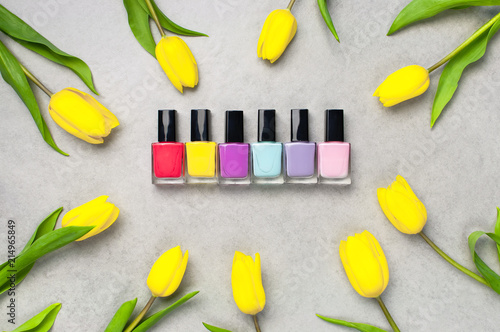 Set Of Different Bright Varnishes For Manicure Nails On A Gray