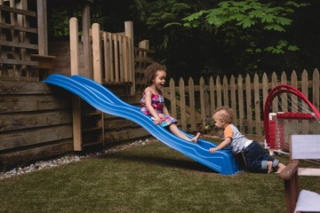 Siblings playing in the garden