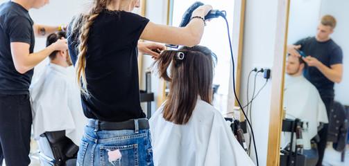 woman drying hair in hair salon