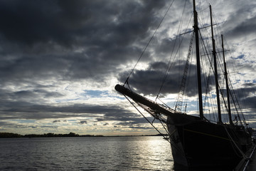 Sunset at the Ontario lake with tall ship standing at marina