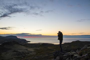 Photographer watching the sun set