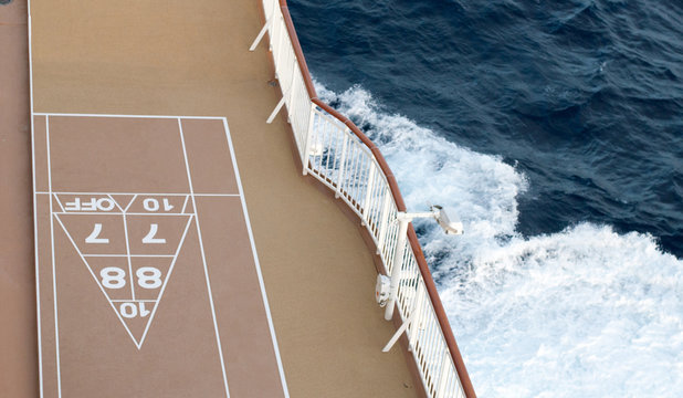 Game on!  Shuffle board on a cruise ship ready for playing