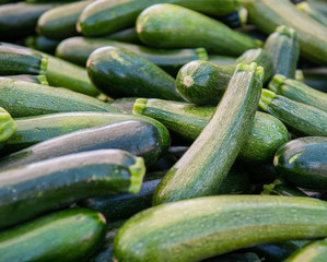 Stacks of green zucchini at the farmers market