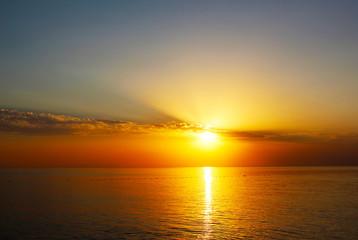 Seascape with sundown sun