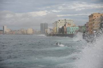 Waves crashing on the charming Malecon promenade of the City of Havana Cuba
